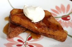 I made this Puffed French Toast (Our Best Bites) tonight for dinner and we all loved it!  We did decide it is naughty enough to only be in the meal rotation once or twice a year for special occasions.  I also made their caramel syrup and we poured it over the top.  Deep fried egg, flour, milk, sugar dredged bread rolled in cinnamon sugar and covered in caramel syrup...how can it not be good?!