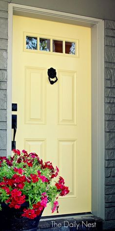 Pale yellow with a grey house... and black hardware again ~!~ Beautiful Front Door Paint Colors - Satori Design for Living