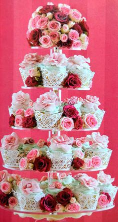 I you are going to have cupcakes at your wedding this is the way that they should look your colors of flowers in between the cupcakes with pretty cupcake liners..its all about the presentation