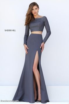 Size 4 Gunmetal Sherri Hill 50209 Long Sleeve 2pc Prom Gown-Style 50209 from Sherri Hill is a long sleeve two piece prom gown with beaded bodice and high slit.