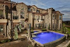 Tuscan Style Home with Pool and Hot Tub. By KGA Studio Architects, PC.
