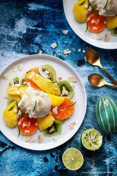 Citrus- and ginger-marinated fruit with coconut ice cream. Recipe: Mari Bergman, Photo & Styling: Sanna Livijn Wexell.