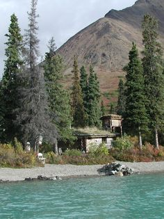 """Proenneke Cabin Museum, Twin Lakes, Lake Clark National Park and Preserve, Alaska - Richard Louis """"Dick"""" Proenneke (born May 4, 1916 – April 20, 2003) was an American naturalist who lived alone in the high mountains of Alaska at a place called Twin Lakes. He moved to Alaska at age 52 and built his cabin using only hand tools. Proenneke made valuable recordings of both meteorological and natural data. He thrived in complete isolation for nearly 30 years, moving back to civilization at age 82."""