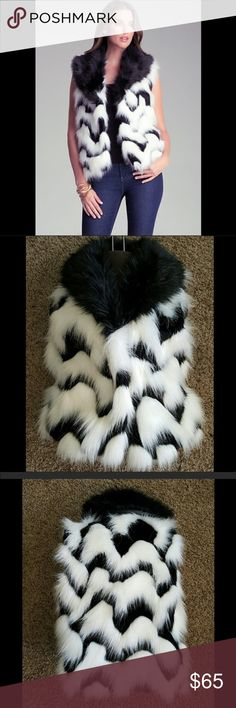 New 💕BEBE💕 Faux Fur Vest New Bebe Faux Fur vest! Black and White in Excellent condition. Has 2 clasps in front to close it up. Size S but could fit M. Length 23 inches. bebe Jackets & Coats Vests