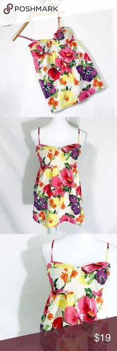 "LC Lauren Conrad Floral Halter Top Say Hello to Spring in this LC Lauren Conrad halter top. Materials: shell 100% Cotton. Lining 65% Polyester, 35% Cotton.    Size M   Measurements (laid flat) Armpit to armpit 13.5"" with expandable back elastic  Waist 14.5"" Length 19"" from top of chest. Adjustable straps provide extra length   Condition Excellent condition pre-owned. No flaws noted. LC Lauren Conrad Tops Tank Tops"