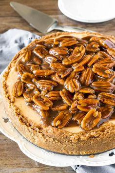Extra creamy cheesecake with a delicious pecan pie topping, and cinnamon pecan graham cracker crust! This pecan pie cheesecake is a seriously next-level dessert! Pecan Pie Cheesecake, Cheesecake Recipes, Dessert Recipes, Dessert Ideas, Coffee Cheesecake, Pie Tops, Salty Cake, Savoury Cake, Pecans