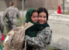 A beautiful moment between a US servicewoman and an Afghan child