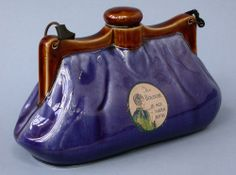 'The Boudoir' stoneware hot water bottle in the form of a lady's purse