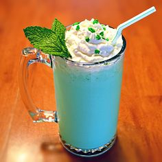 Boozy Shamrock Shake :: 1 (48oz) container vanilla ice cream, ½ cup creme de menthe, ⅓ cup Jameson whiskey, ⅓ cup Bailey's Irish creme, Whipped cream, to top (optional), Mint leaves and/or sprinkles, to garnish (optional)
