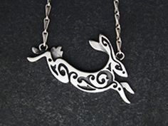 As we listened, I figured the necklace at my throat, that one that Eirik had made for me from bone, a leaping hare.