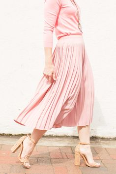 1621c09b03ca Cathy shares how to style a pink pleated skirt by pairing it with a similar  color J.Crew Tippi Cardigan to create a sweet monochromatic look!