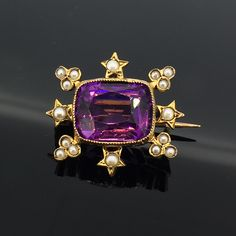 Victorian seed pearl and amethyst brooch in 9ct yellow gold. £325