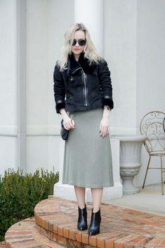 Winter pastel colors: sage green midi dress, black faux fur jacket - winter outfit by petite style blogger AnnRobieFashion