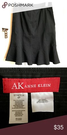 Ann Klein Skirt This petite skirt by Ann Klein is made of stretch material and super comfortable!  Size 6, with a classy pinstripe vertically.  Very appropriate to wear for work or evening out... Anne Klein Skirts