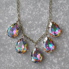 Hey, I found this really awesome Etsy listing at https://www.etsy.com/listing/212463350/rainbow-necklace-swarovski-crystal-dark
