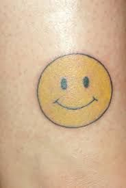 Janet had a tiny smiley face tattoo on her ankle, from the first time she beat cancer.