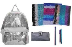 """Silver Sequin 15"""" Backpack & ULTIMATE Back to School Set Includes Sequin Folders, Spiral, Pencil Case, and More by Ultimate Back To School Sets. $59.95. It's her time to shine in the classroom. This girls' Skechers backpack is covered with sequins for sensational sparkle. Complete with a front pocket, this backpack promises to keep her school things in order.. This limited edition Twinkle Toes by Skechers Silver Sequin Backpack & ULTIMATE Back to School Set include..."""