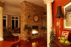 good image. Floor to ceiling stack stone w/o hearth or mantle.
