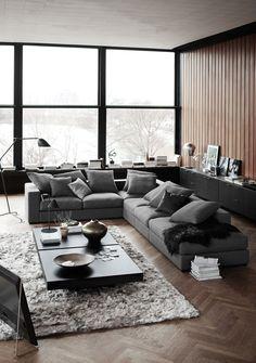 Móveis e acessórios para um living aconchegante em cinza, marrom e preto
