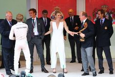 The Monegasque royals having a great time handing out the prizes at this year's Formula One Monaco Grand Prix.