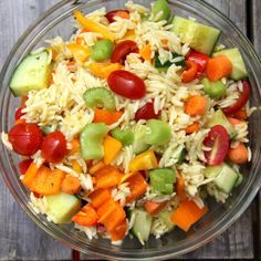 An orzo salad that's packed full of vegetables and tossed in a lemon dressing.