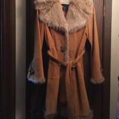 Faux fur and shearling Tan Long Coat Faux fur and shearling Tan Long Coat. Worn only a few times. Excellent condition but has a very small material flaw down at bottom of coat closure. Terry Lewis Jackets & Coats