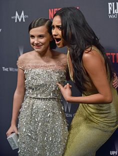 Millie Bobby Brown (L) and Shay Mitchell arrive at the Weinstein Company and Netflix 2017 Golden Globes after party at the Beverly Hilton in Beverly Hills, California on January 8, 2017.