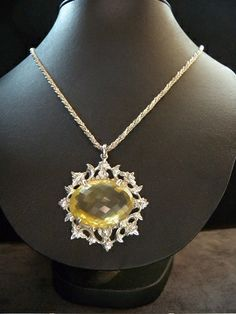 Silver pendant with a huge citrine, from the early 1900's in the rococo style. Powerful and stylish to wear in summer.    Stamped: 800  Pendant height: 5.2 cm  Width: 4.5 cm  Citrine height: 31 mm  Width 22 mm  Chain length: 50 cm  Weight: 35.6 gr