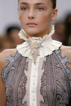 Description: Balenciaga at Paris Fashion Week Spring 2006. This collar is similar to the ruff/betsy style used in the Empire Period. It is not as large as the collars used then but still makes a statement.