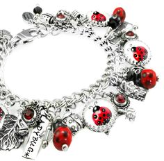"My jewelry store features handmade jewelry, charm bracelets, necklaces, earrings, this beautiful "" 1940's Pinups"" silver charm bracelet and over 400 more unique jewelry designs. My jewelry is created"