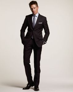 You can't go wrong here. A navy suit is always a safe, classic choice, and it travels seamlessly from the boardroom to an evening out. It le...