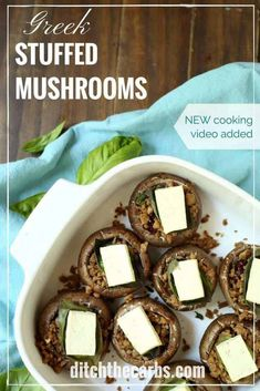 Low-carb and keto Greek stuffed mushrooms. Watch the quick cooking video to see how easy it is to make. Perfect as a snack or meal. Grain free, gluten free healthy meal. | ditchthecarbs.com