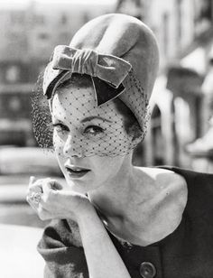 Flamingo velvet pillbox hat with a pleated front and bow from the Autumn Collection by Christian Dior Chapeaux Ltd, being modeled in London by Jill Leslie by http://tupersonalshopperviajero.blogspot.com.es/2013/08/5-women-with-vintage-veiled-hat.html