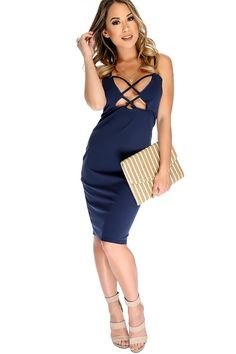 This bold and stylish dress is the perfect go to for a night out! Featuirng; sleeveless, caged, front cut out, back zip closure. Followed by a fitted wear. 95% Polyester 5% Spandex