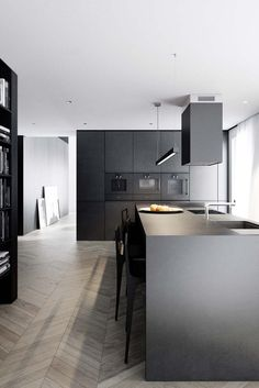 Dark kitchen that make a bold statement. Nice contrast with floor.