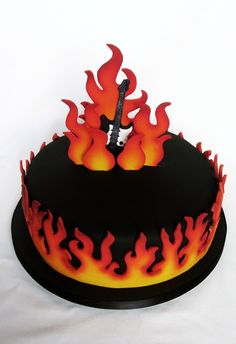 flame guitar cake.  Very interesting