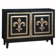 This hand painted distressed midnight black and gold finish accent chest features two doors with an adjustable shelf inside. The chest offers gold finish hardware