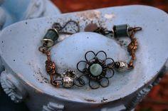 Handcrafted copper flower bracelet.