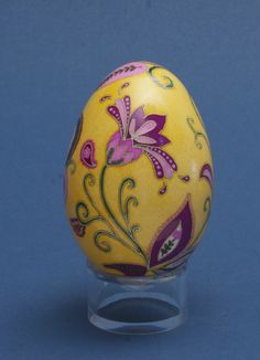 Abstract purple and pink flowers on yellow goose egg