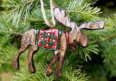 Items similar to Hand Carved Moose with Quilt Ornament on Etsy