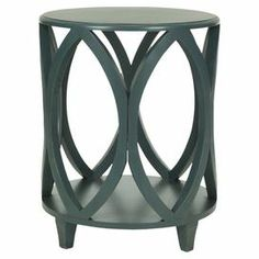 """Brimming with artful craftsmanship, this openwork pine side table is perfect for your bedside or next to the sofa.   Product: Framed printConstruction Material: Poplar woodColor: Dark tealFeatures: Openwork sidesDimensions: 24.5"""" H x 19.75"""" Diameter"""