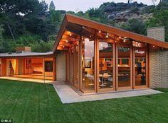House of glass: The 2,916 square feet of living space seems larger thanks to floor-to-ceiling windows