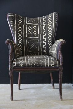 Mud cloth covered chair with black and white tribal pattern