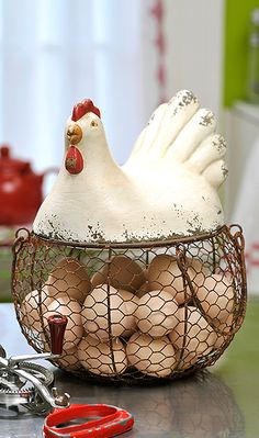 Faux brown eggs sitting in this basket would be a nice touch for my 'farmhouse'-theme dining room!  (Basket by:Caffco International)