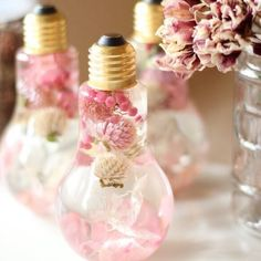 花が舞う桜色ピンクの電球フラワリウム™