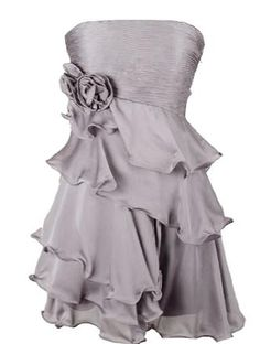 Whipped Delight Dress: Features a chic strapless cut with a finely shirred bodice, two origami-style flowers blooming to the right, adjustable ribbon ties which tighten below a smocked backside, and breathtaking ruffles spilling asymmetrically down the front to finish.