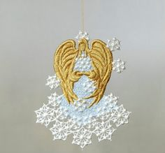 Pamper yourself or a friend with a touch of handmade elegance! Use this unique machine embroidered Lace Peace Angel as the way to keep your