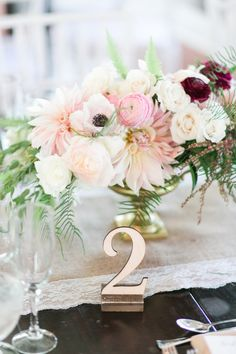 pink and white ranunculus and poppy wedding centerpiece
