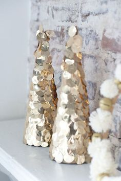 Wrap a gold garland around a cone shape to make glitzy Christmas tree cones.