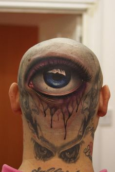 Eyeball head tattoo by John Anderton